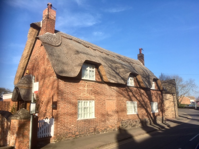 Thatched Cottage in the Autumn Sunshine
